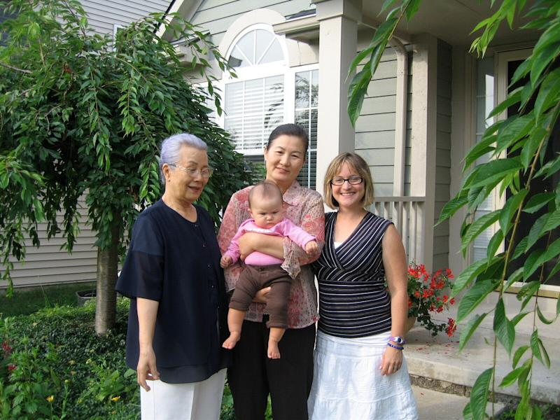 Kendra Stanton Lee (right) with her daughter, Madigan, and Madigan's great-grandmother Myung Namm (far left) and grandmother Mi Ja Lee, in 2008. (Photo: Courtesy of Kendra Stanton Lee)