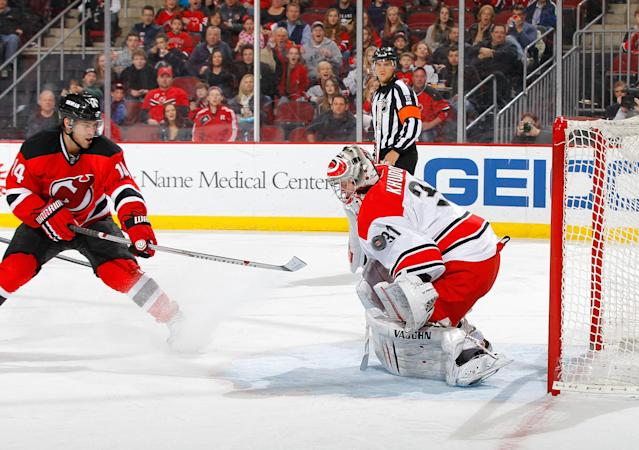 NEWARK, NJ - MARCH 08: Anton Khudobin #31 of the Carolina Hurricanes surrenders a second-period goal against Adam Henrique #14 of the New Jersey Devils at the Prudential Center on March 8, 2014 in Newark, New Jersey. (Photo by Jim McIsaac/Getty Images)