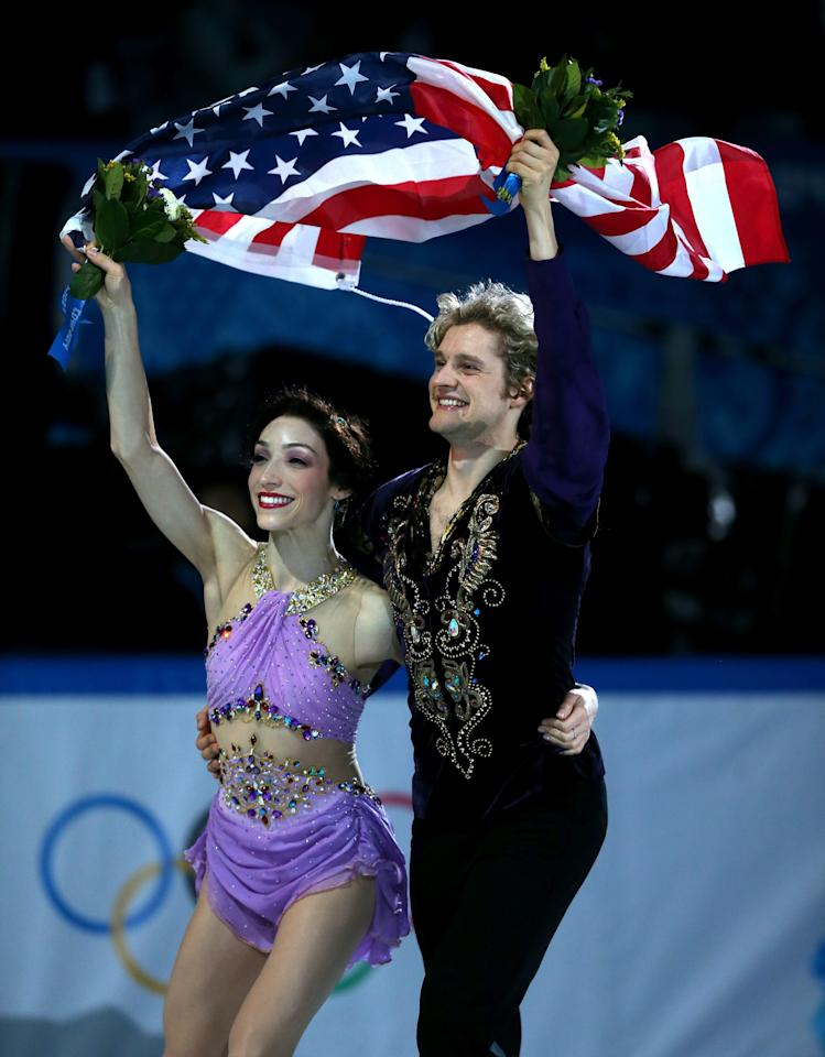 SOCHI, RUSSIA - FEBRUARY 17: Gold medalists Meryl Davis and Charlie White of the United States celebrate during the flower ceremony for the Figure Skating Ice Dance on Day 10 of the Sochi 2014 Winter Olympics at Iceberg Skating Palace on February 17, 2014 in Sochi, Russia. (Photo by Matthew Stockman/Getty Images)