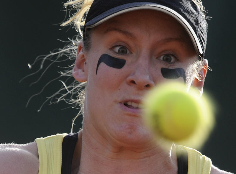 USA's Bethanie Mattek-Sands eyes the ball as she plays Spain's Arantxa Parra Santonja during their first round match for the French Open tennis tournament, at the Roland Garros stadium in Paris, Sunday, May, 22, 2011. (AP Photo/Laurent Baheux)