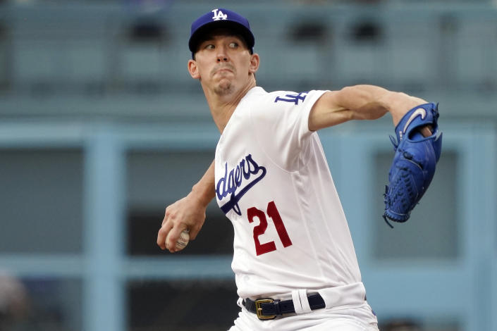 Los Angeles Dodgers starting pitcher Walker Buehler throws to a San Francisco Giants batter during the first inning of a baseball game Thursday, July 22, 2021, in Los Angeles. (AP Photo/Marcio Jose Sanchez)