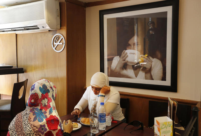 Women dine in a cafe in Cairo, Egypt, Tuesday, Sept. 10, 2013. While street violence and political unrest have engulfed Egypt since the military coup that ousted President Mohammed Morsi in July, Egyptians still try to go about heir daily lives. (AP Photo/Lefteris Pitarakis)