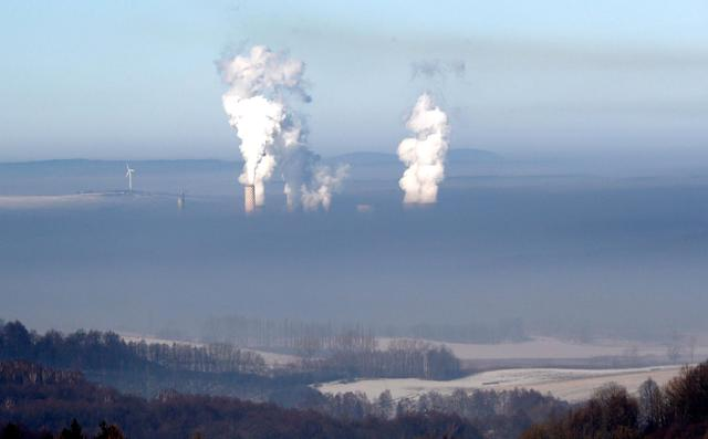 <p>Smoke rises from chimneys of the coal-fired power plant in Bogatynia, Poland. The picture was taken from a hill near the town of Frydlant, Czech Republic, Tuesday, Feb. 14, 2017, as smog across coal-addicted Poland hit crisis levels recently. (AP Photo/Petr David Josek) </p>