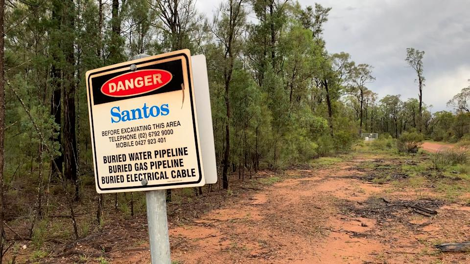 A Santos pipeline sign in the Pilliga State Forest.