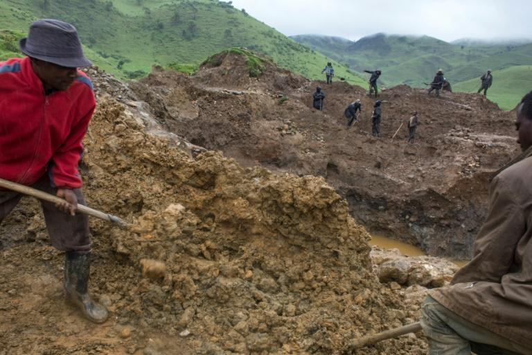 Self-employed miners digging for cassiterite near Numbi in hilly eastern Democratic Republic of Congo