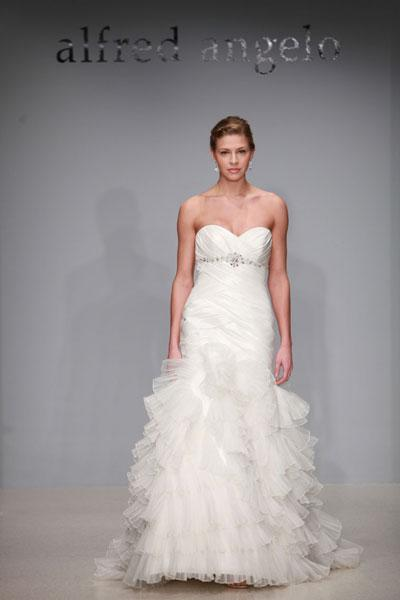 """<div class=""""caption-credit""""> Photo by: Alfred Angelo</div><div class=""""caption-title"""">13. Alfred Angelo</div>Pleated ruffles and crystal detailing at the bodice add major wow-factor to this Alfred Angelo gown. <br> <br> Check out more gorgeous styles in our <a rel=""""nofollow noopener"""" href=""""http://www.bridalguide.com/photo-galleries/bridal-gowns/alfred-angelo/style-2183"""" target=""""_blank"""" data-ylk=""""slk:Alfred Angelo gown gallery"""" class=""""link rapid-noclick-resp"""">Alfred Angelo gown gallery</a>!"""