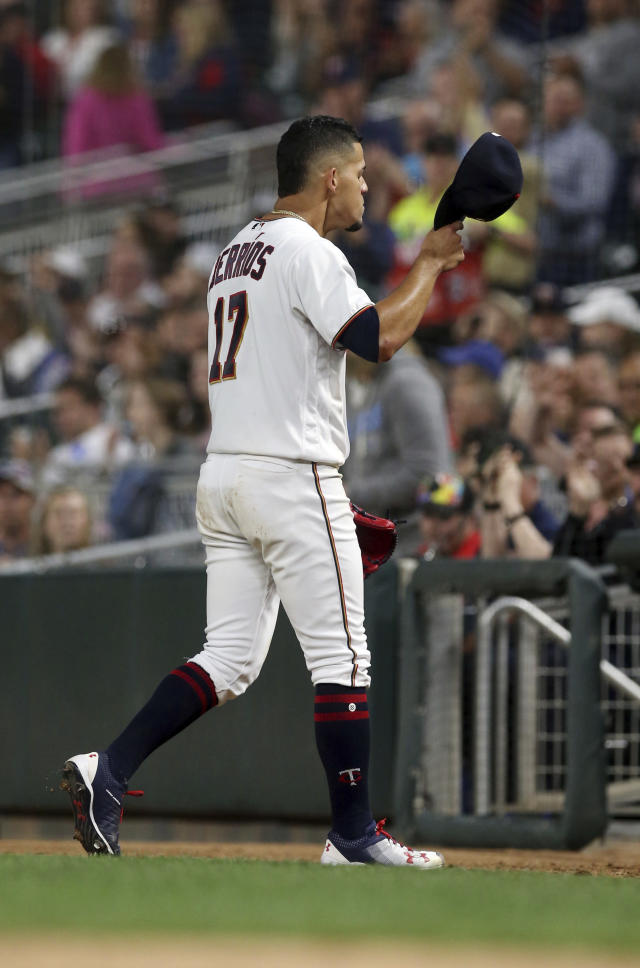 Minnesota Twins pitcher Jose Berrios doffs his cap after he was pulled in the seventh inning of the team's baseball game against the Boston Red Sox on Tuesday, June 19, 2018, in Minneapolis. The Twins won 6-2. (AP Photo/Jim Mone)