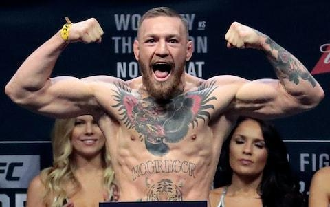 <span>Conor McGregor poses for the cameras during a UFC weigh-in</span> <span>Credit: AP </span>