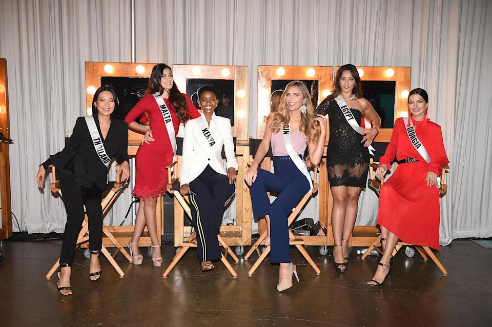 Angela Ponce (middle right) posing with her fellow contestants. [Photo: Getty]victo