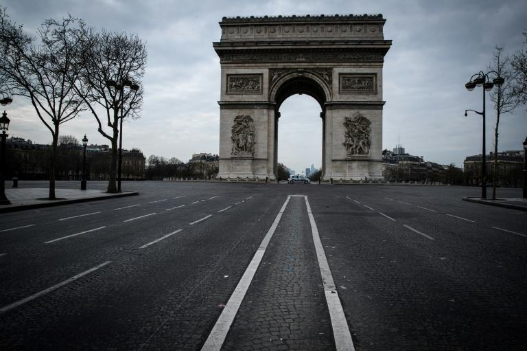 Normally, hundreds of people jostle for a clear shot of the Arc de Triomphe