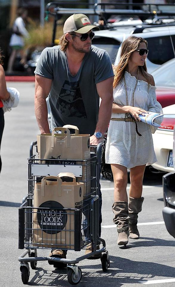 "Aussie actor Chris Hemsworth and his wife Elsa Pataky carried out bags from Whole Foods in Venice, California, on Wednesday. ""Thor"" needs fuel for all those muscles! <a href=""http://www.splashnewsonline.com"" target=""new"">Splash News</a> - August 24, 2011"