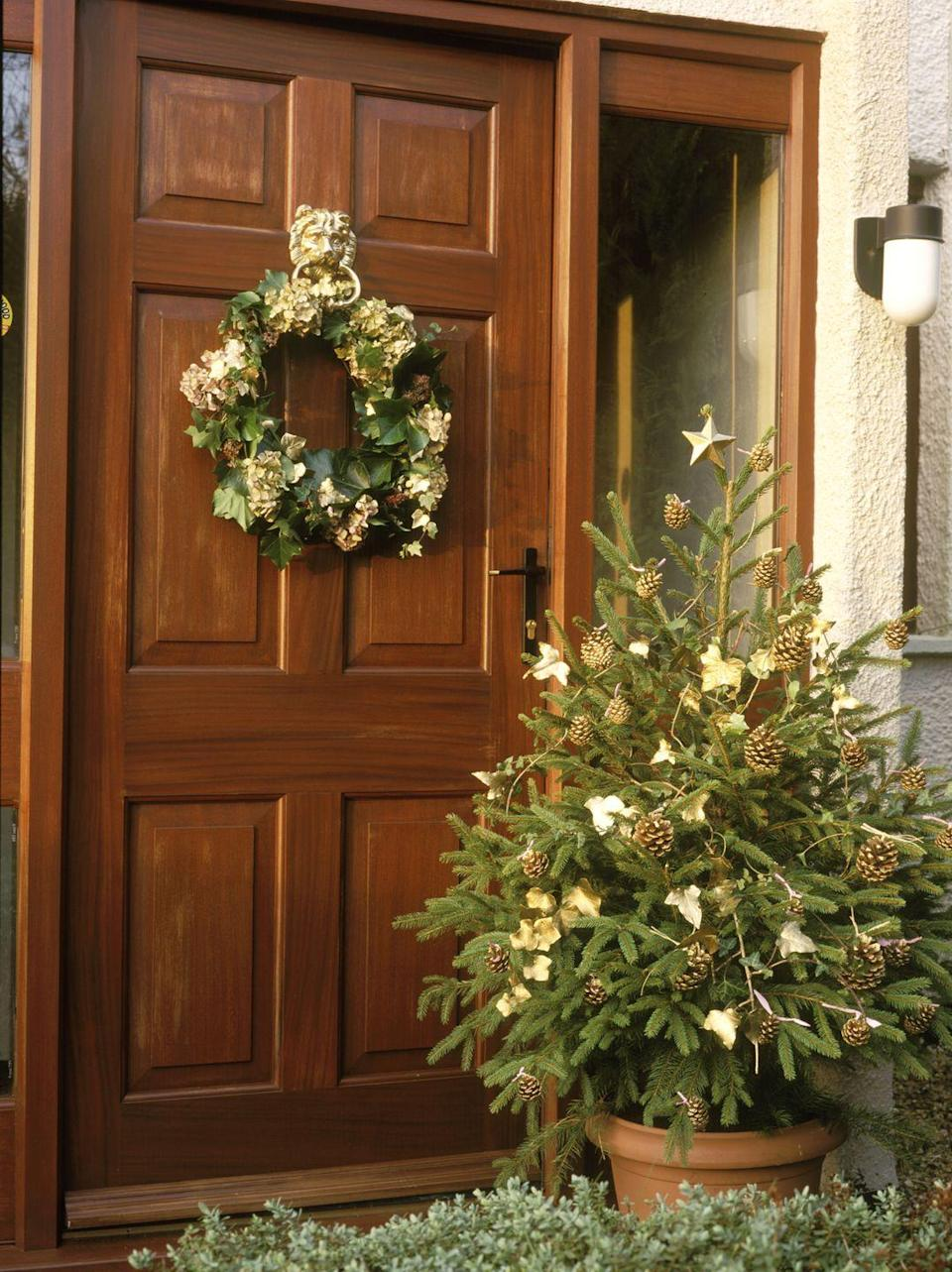 <p>To dazzle guests from the moment they arrive, incorporate gilded pinecones into your outdoor vignettes, by either adorning your door with a gold pinecone wreath or accenting fresh greenery with gold pinecone ornaments. It's an elevated approach to a classic winter motif. </p>