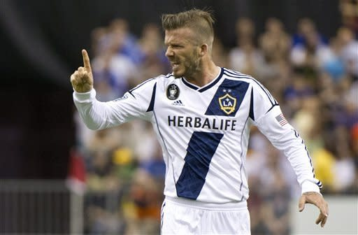 Los Angeles Galaxy's David Beckham argues a call with the referee during the first half of an MLS soccer game against the Montreal Impact in Montreal on Saturday, May 12, 2012. (AP Photo/The Canadian Press, Paul Chiasson)