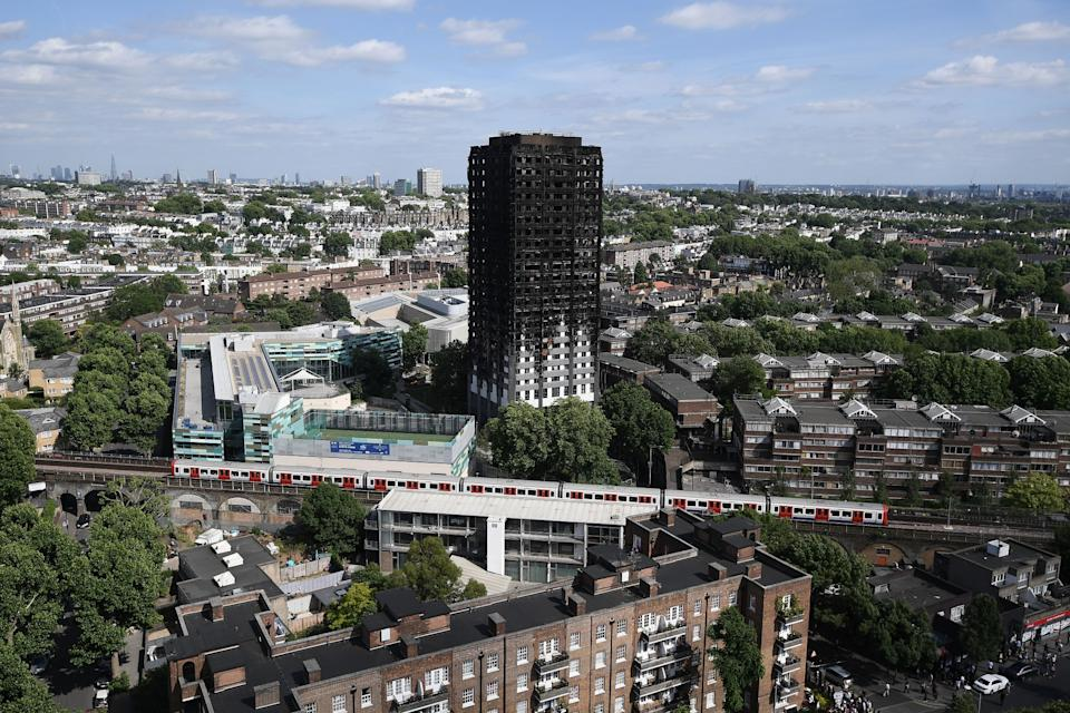 <p>The remains of Grenfell Tower stand tall in the west London skyline; a stark reminder of the devastation that unfolded as a result of the inferno that ripped through the 24-storey building on Wednesday, June 14. (GETTY) </p>