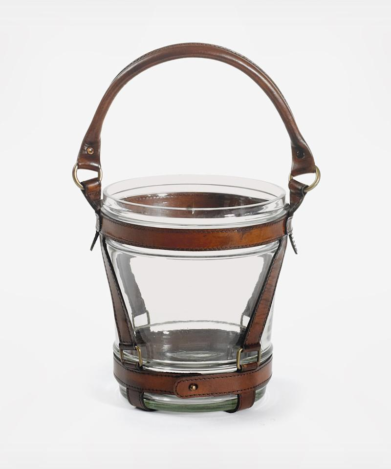 "<p>Brown leather accents turn this ordinary glass wine cooler into a rugged-cool bar cart accessory.</p><p>$188 | <a rel=""nofollow"" href=""https://www.zola.com/shop/product/gohome_wesley_wine_cooler_10?skuId=54efa600e4b09f7533a75f5b&collectionItemId=565d16b9e4b0fe73207aa52a&utm_source=InStyle&utm_campaign=Gifts_Grooms_Love&utm_medium=Referral"">SHOP IT</a></p>"