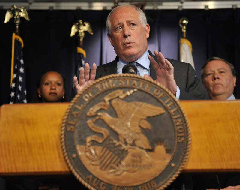 """Illinois Gov. Pat Quinn speaks at a news conference in Chicago, Thursday, Sept. 8, 2011. Gov. Pat Quinn announced Thursday that he'll try to close seven state institutions and lay off more than 1,900 employees in an effort to live within the reduced budget approved by the Illinois Legislature, and he challenged lawmakers not to """"run away"""" from the impact of their decisions.  (AP Photo/David Banks)"""