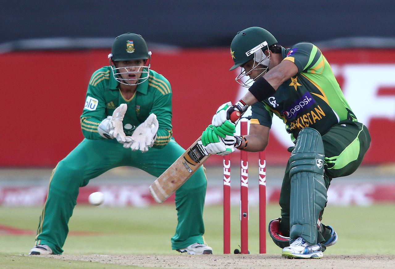 CAPE TOWN, SOUTH AFRICA - NOVEMBER 22: Umar Akmal of Pakistan square drives a delivery during the 2nd T20 International match between South Africa and Pakistan at Sahara Park Newlands on November 22, 2013 in Cape Town, South Africa. (Photo by Shaun Roy/Gallo Images/Getty Images)