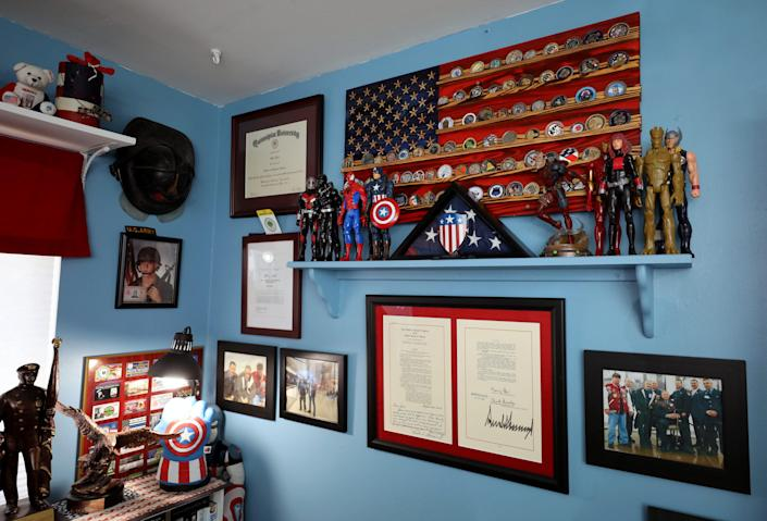 The office in John Feal's home in Nesconset, New York, is filled with Captain America and Deadpool references, as pictured April 6, 2021. Feal, who established the FealGood Foundation, has become a leading activist in getting the 9/11 James Zadroga Act, the WTC Health Program and the 9/11 Victims Compensation Fund, passed and then renewed and then made permanent.