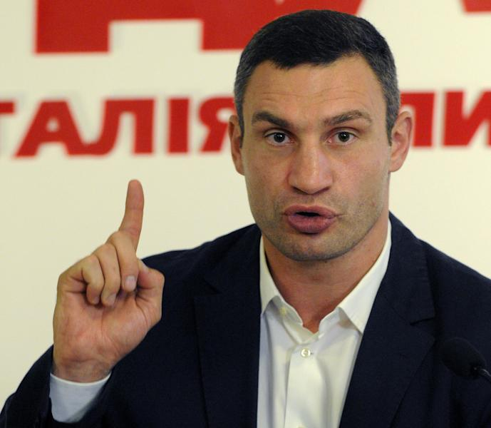 WBC Heavyweight Champion and Chairman of the Ukrainian democratic opposition Ukrainian Democratic Alliance for Reform Party Vitali Klitschko, answers questions, during a news conference in Kiev, Ukraine, Monday, Oct. 22, 2012. Parliamentary elections are scheduled for Oct. 28.(AP Photo/Sergei Chuzavkov)