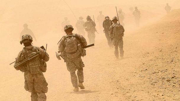 PHOTO: In this April 3, 2010, file photo, U.S. soldiers walk during a patrol in Yosef Khel district of Paktika province in Afghanistan. (Massoud Hossaini/AFP via Getty Images, FILE)