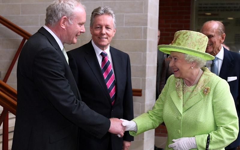 The Queen shakes hands with Martin McGuinness during an historic meeting in 2012 - Credit: Paul Faith/PA