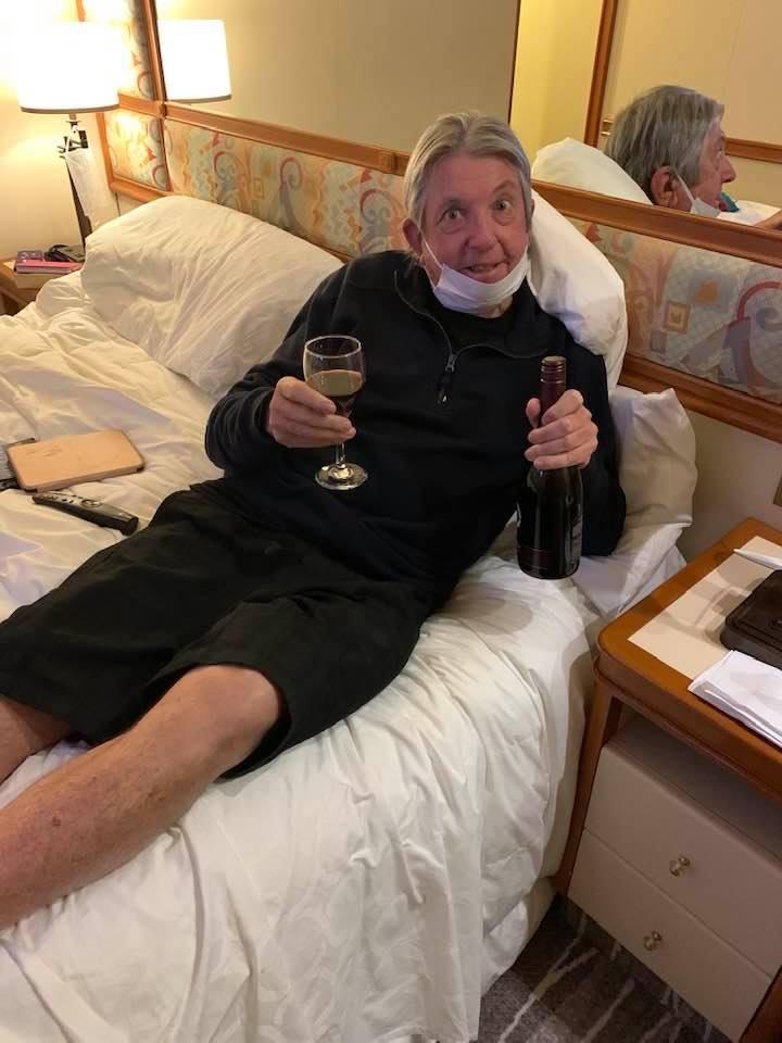 Dave Binskin, from Palm Beach, Queensland, appeared pleased to have the wine as he continues to be quarantined on the Diamond Princess cruise ship.