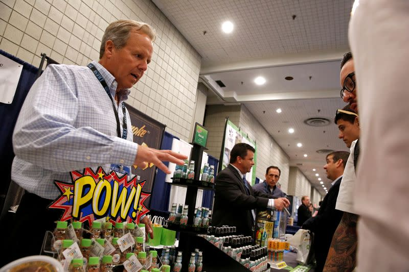 FILE PHOTO: A representative of a cannabis-based product company interacts with attendees during the Cannabis World Congress & Business Exposition in New York City