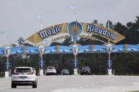 Park guests enter the Magic Kingdom during the reopening of Walt Disney World Saturday, July 11, 2020, in Lake Buena Vista, Fla. (AP Photo/John Raoux)