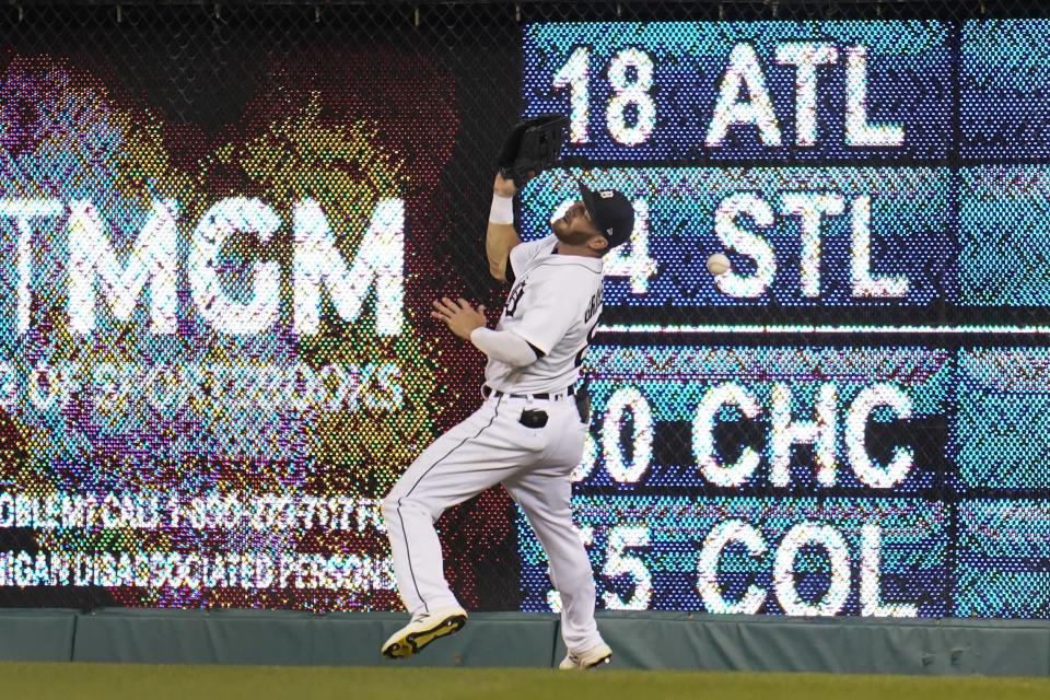 Detroit Tigers right fielder Robbie Grossman misses a Boston Red Sox Alex Verdugo (99) fly ball in the sixth inning of a baseball game in Detroit, Wednesday, Aug. 4, 2021. (AP Photo/Paul Sancya)