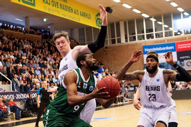 Basketball - FIBA Europe Cup - Bakken Bears vs Sidigas Scandone Avellino - Aarhus, Denmark - April 18, 2018 - Bakken Bears' Chris Christoffersen and Tony Bishop in action with Sidigas Scandone Avellino's Olaseni Abdul-Jelili Lawal. Scanpix Denmark/via REUTERS ATTENTION EDITORS - THIS IMAGE WAS PROVIDED BY A THIRD PARTY. DENMARK OUT. NO COMMERCIAL OR EDITORIAL SALES IN DENMARK