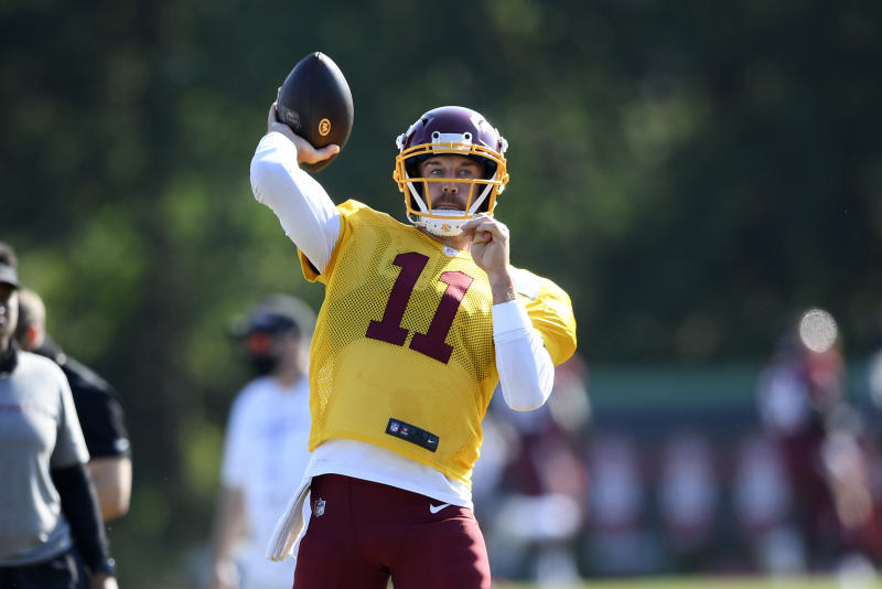 Washington quarterback Alex Smith passes the ball during practice at the team's NFL football training facility.