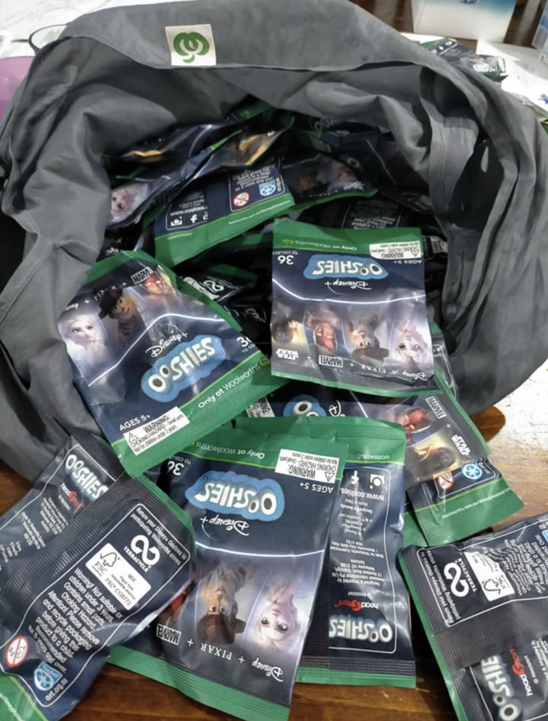 A Woolworths bag filled with Ooshie collectibles.