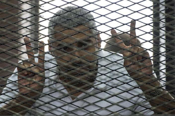 File picture taken on June 23, 2014 shows Al-Jazeera's Egyptian-Canadian journalist Mohamed Fahmy during his trial for allegedly supporting the Muslim Brotherhood at the police institute near Cairo's Tora prison (AFP Photo/Khaled Desouki)