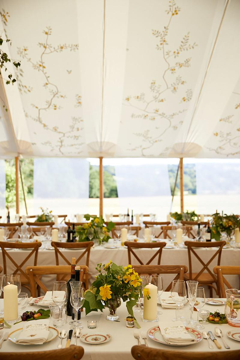 I'd gathered wild flowers from the surrounding countryside in my chosen color palette of yellows, whites, and greens for the tables.