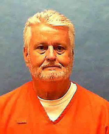 Florida death row inmate Bobby Joe Long, convicted of the 1984 murders of eight women, poses for a prison photo at Florida State Prison in Raiford