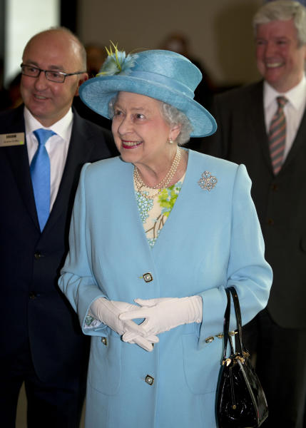 Britain's Queen Elizabeth II smiles during a visit to officially open the headquarters of the British Broadcasting Corporation's new Broadcasting House in central London, Friday June 7, 2013. (AP Photo/Arthur Edwards, Pool)