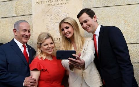 Israeli Prime Minister, Benjamin Netanyahu, and his wife, Sara, take a selfie with Ivanka Trump and Jared Kushner at the opening of the new embassy - Credit: Israel Press Office /Handout/Anadolu Agency/Getty Images
