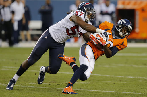 Denver Broncos wide receiver Emmanuel Sanders (10) is tackled by Houston Texans outside linebacker Justin Tuggle (57) during the first half of an NFL preseason football game, Saturday, Aug. 23, 2014, in Denver. (AP Photo/Jack Dempsey)