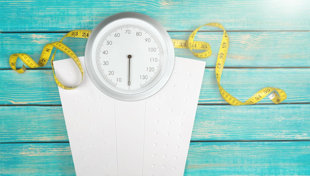 A Measuring Tape on a Weight Scale