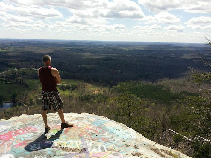 Edward Watson stands atop Currahee Mountain in northeastern Georgia on March 26, 2020. The Toccoa, Ga., resident has been quarantining alone during the COVID-19 pandemic and has been taking drives into the mountains to break up his isolation.