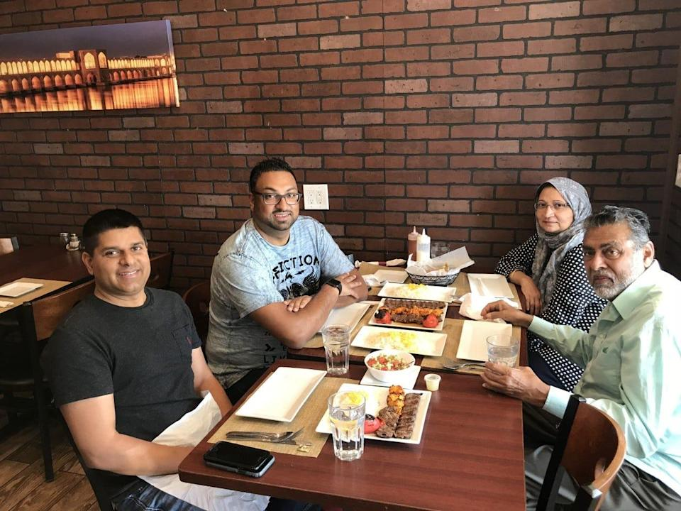 Sameer Sarmast sits with his cousin Sameer Ahmed and his parents, Amina and Syed Sarmast, at their favorite restaurant Kabob on the Cliff in New Jersey.