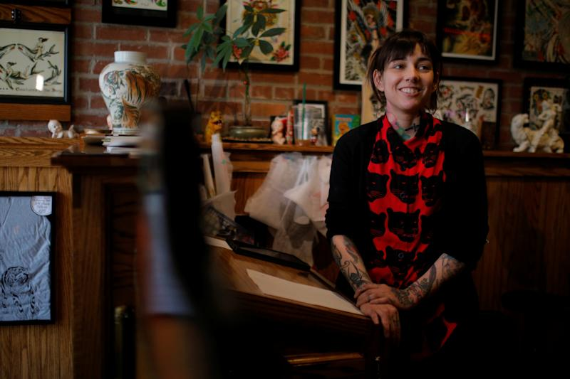Ashley Matthias, tattoo artist at Bulletproof Tiger Tattoo, speaks to Reuters in Manchester, New Hampshire, U.S., March 28, 2018. Picture taken March 28, 2018. REUTERS/Brian Snyder