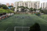Deportivo Petare Futbol Club's players take part in a training in a sport center in Caracas