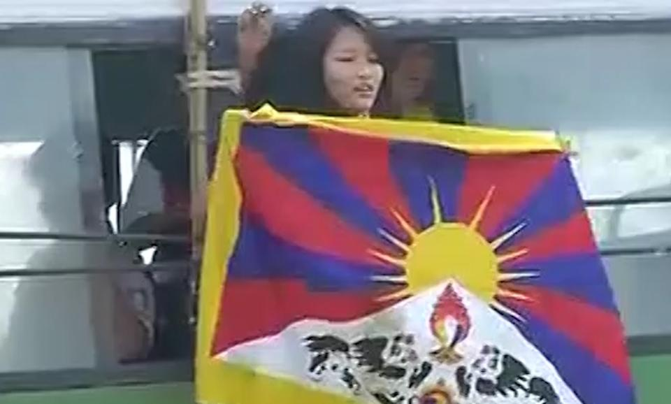 Tibetan student outside Chinese Embassy in India