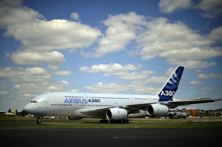 An Airbus A380-800 taxis for take off at the Farnborough air show in Hampshire, England, on July 14, 2014