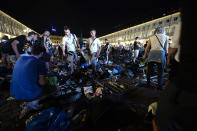 <p>Juventus supporters look for personal belongings at Piazza San Carlo after a panic movement in the fanzone where thousands of Juventus fans were watching the UEFA Champions League Final football match between Juventus and Real Madrid on a giant screen, on June 3, 2017 in Turin. (Massimo Pinca/AFP/Getty Images) </p>