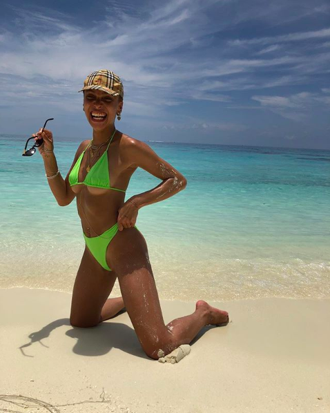 <p>In case you needed any further evidence that nineties swim attire is well and truly back this season, model Adwoa Aboah donned an old school Burberry cap and neon bikini on her most recent holiday. <em>[Photo: Instagram]</em> </p>