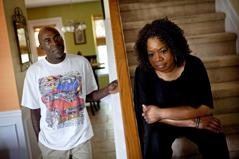 Michael, left, and Patricia Jackson are photographed in their home Saturday, June 16, 2012, in Marietta, Ga. On a suburban cul-de-sac northwest of Atlanta, the Jacksons are struggling to keep a house worth $100,000 less than they owe. Their voices and those of many others tell the story of a country that, for all the economic turmoil of the past few years, continues to believe things will get better. But until it does, families are trying to hang on to what they've got left. The Great Recession claimed nearly 40 percent of Americans' wealth, the Federal Reserve reported last week. The new figures, showing Americans' net worth has plunged back to what it was in 1992, left economists shuddering. (AP Photo/David Goldman)