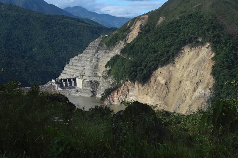 The officers were killed in an area where locals have been evacuated over potential flooding and landslides from the Hidroituango dam project, pictured, which is at risk of collapse