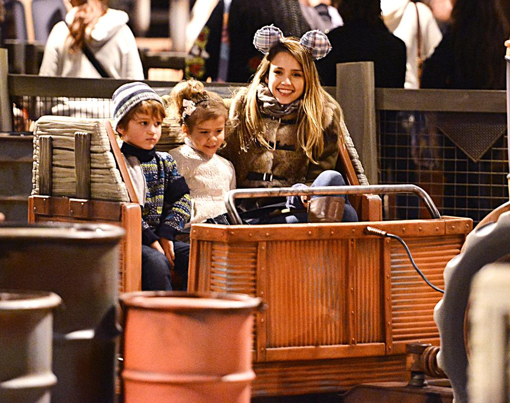 EXCLUSIVE: Jessica Alba and husband Cash Warren were spotted at the happiest place on earth with their kids over the weekend. The family spent Saturday and Sunday at the Disneyland Resort, visiting both the Magic Kingdom and California Adventure parks. The actress and her family were seen getting on rides such as Space Mountain, Pirates of the Caribbean and Indiana Jonas at Disneyland, and checking out the new rides like Mater's Junkyard, Radiator Springs and Luigi's Flying Tires, in the new Cars Land located in California Adventure. Jessica was also seen wearing stylish Mickey ears. Pictured: Jessica Alba and Honor Warren Ref: SPL472831 171212 EXCLUSIVE Picture by: Sharpshooter Images / Splash Splash News and Pictures Los Angeles: 310-821-2666 New York: 212-619-2666 London: 870-934-2666 photodesk@splashnews.com